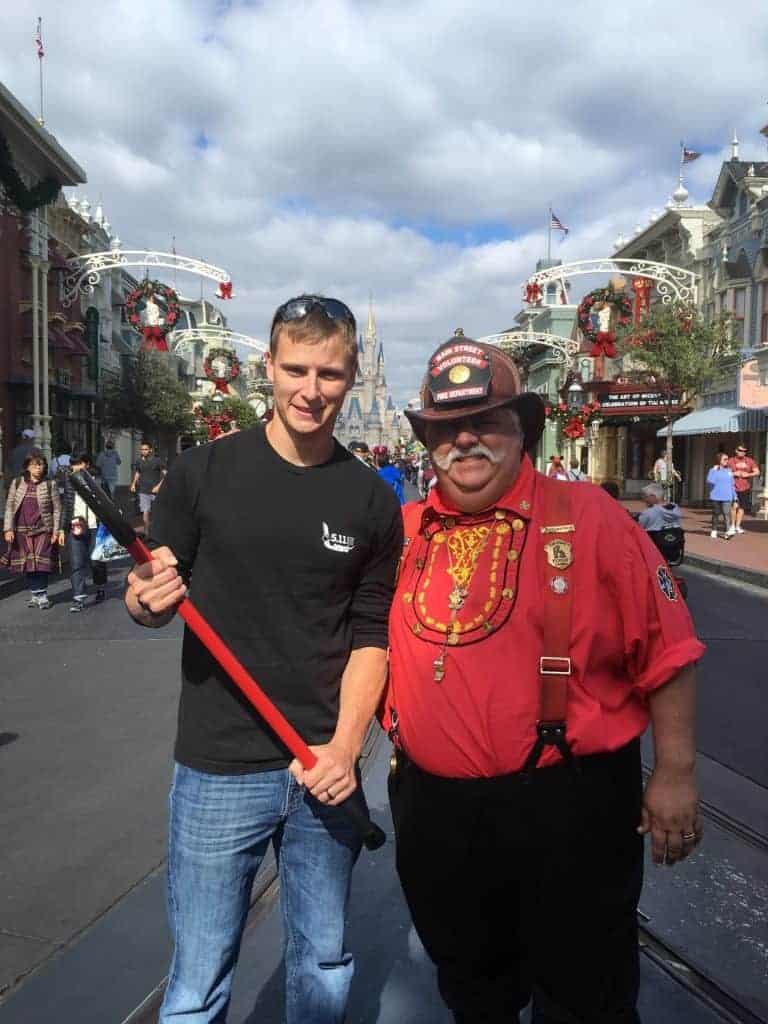 "Volunteer Main Street Firefighter- one of the many cool things you will ""find"" at Disney when you least expect it."